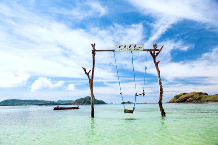 paradise beach: Swings in paradise island at tropical beach, sunny day, good weather. Stock Photo