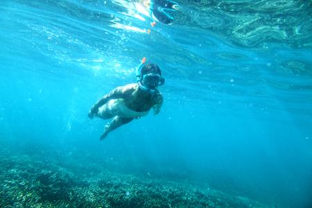 snorkeling: Woman is snorkeling underwater