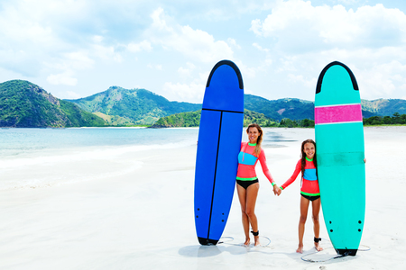 adventure holiday: Mom with child are learning surfing together Stock Photo