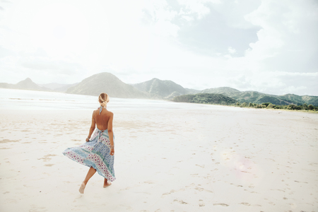 pretty dress: Woman wearing ethnic flying dress walking barefoot at the beach, Lombok, Indonesia