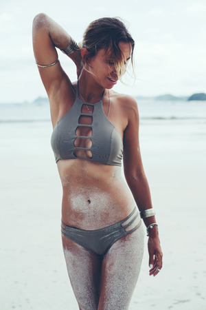 gipsy: Beautiful bohemian styled and tanned girl at the beach Stock Photo