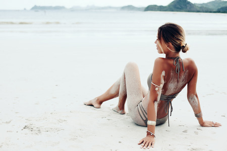 tanned girl: Beautiful bohemian styled and tanned girl at the beach Stock Photo