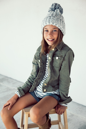 Fashion pre teen girl of 10 years old wearing fall clothing, hipster style