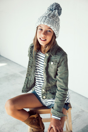 pre teen girl: Fashion pre teen girl of 10 years old wearing fall clothing, hipster style