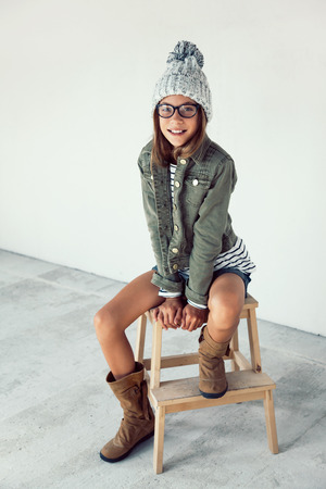 pre: Fashion pre teen girl of 10 years old wearing fall clothing and boots, hipster style Stock Photo
