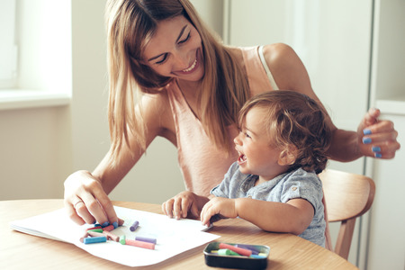Mother playing with her 1,4 years old son, drawing together photo