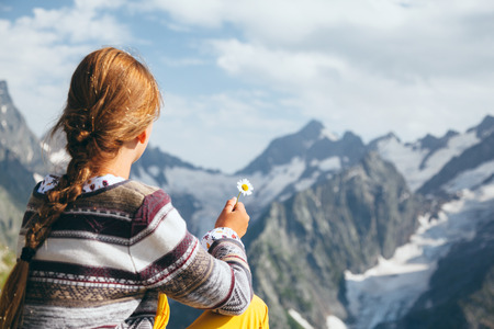 Pre teen child resting on the top of the mountain, alpine view Stok Fotoğraf
