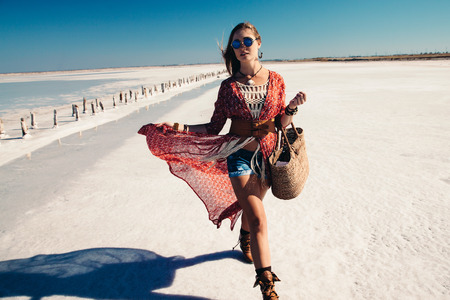 chic: Fashion model wearing bohemian chic clothing posing on the salt beach outdoor.
