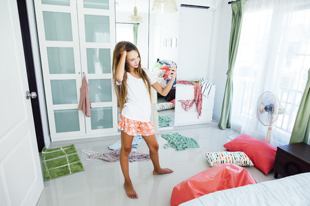 Beautiful 10 Years Old Pre Teen Girl Choosing Outfit In Her Closet. Messy.. Stock  Photo, Picture And Royalty Free Image. Image 72632056.