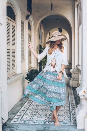 gipsy: Fashion girl wearing bohemian clothing posing in the old city street. Boho chic fashion style.