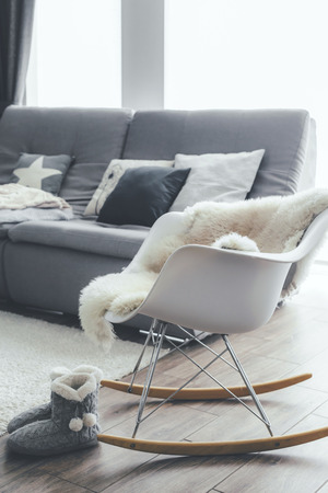 Sheep Skin Rug On Modern Rocket Chair By The Sofa With