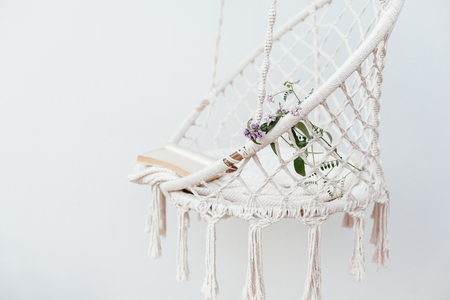 Summer hygge scene with hammock chair on white background. Cozy place for weekend relax in the garden.