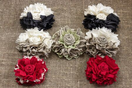 Beautiful letter H made of handmade flowers on a linen canvas