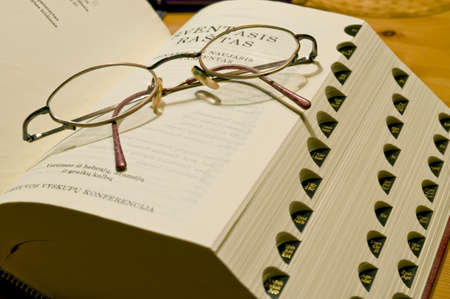 Bible book in the Swedish languageand glasses taken as macro