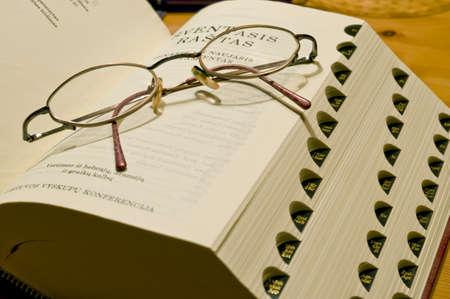 Bible book in the Swedish languageand glasses taken as macro photo