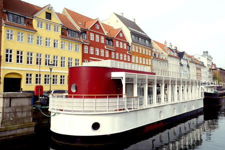 Boatsi in the canal of Nyhavn in Copenhagen, Denmark. Taken on May 2012.