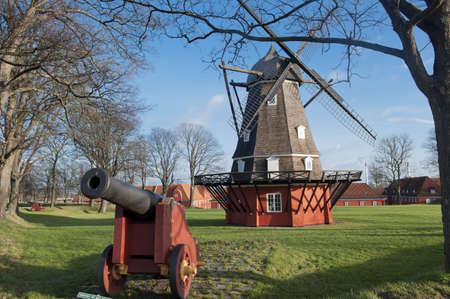 Windmill and old gun in Kastellet fortress in Copenhagen Stock Photo