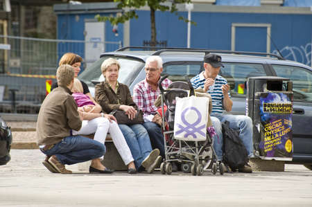 Tourists have a rest in the city, taken in Helsinki, Finland Editorial