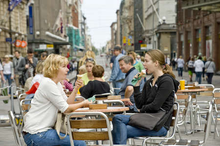 Couple eats ice cream in street cafe Helsinki, Finland Editorial