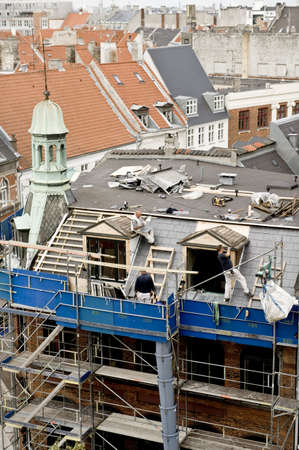 Building roof repair in Copenhagen, Denmark Editorial