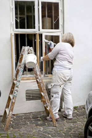 The house painter paints a window. Taken in Copenhagen, Denmark            Stock Photo - 14223554