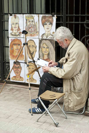 Street artist in Old Arbat street in Moscow Russia, taken on April 2012