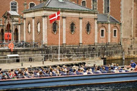 scandinavian peninsula: Group of tourists on an excursion boat in Copenhagen  Taken on June 2012