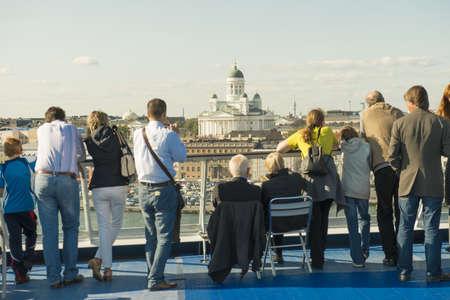 Passangers of cruise ship arrive in Helsinki, Finland. Taken on July 2012.