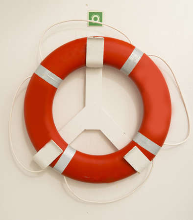 flotation: Red  lifebuoy on board the passenger ship