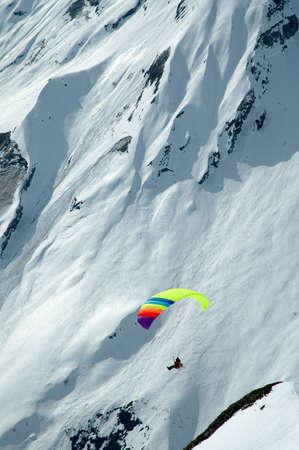 Sion, Switzerland - Paraplane in the Alpine mountains photo