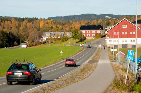 Traditional  Norwegian road through the village in summer time photo