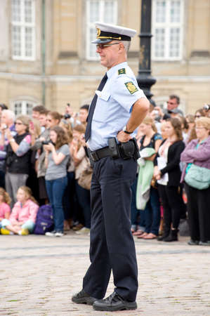 Stockholm, Sweden - August 24, 2011: The Swedish police officer keeps order before ceremony of Sweden Royal Guard.