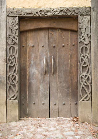 A danish medieval door of a viking house. Taken in a danish viking museum. photo