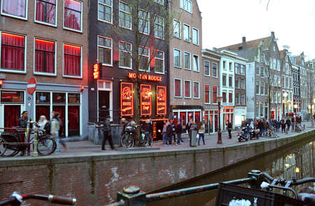 Amsterdam, The Netherlands - April 04, 2014: Red Light District in Amsterdam. Evening View Of Amsterdam Canals. Editorial