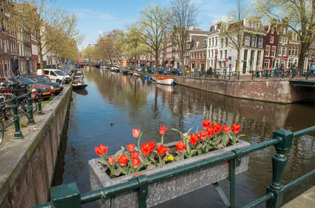 "Amsterdam, The Netherlands - April 05, 2014: Amsterdam is the most watery city in the world. The number of canals have led Amsterdam to become known as ""The Venice of the North"".  Editorial"