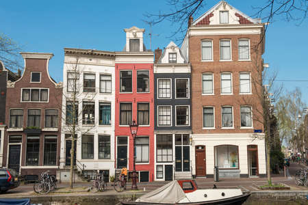 The typical Dutch houses on a blue spring day Amsterdam, Netherlands