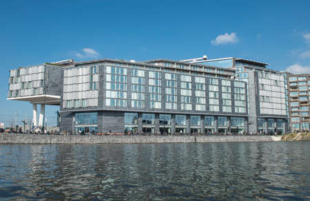 combines: Amsterdam, The Netherlands - April 05, 2014; DoubleTree by Hilton Hotel in Amsterdam is combines elegant modern rooms, business facilities with the latest AV technology, a fitness centre and an ideal location overlooking the water. Editorial