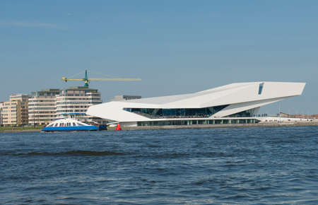 eyecatcher: Amsterdam, The Netherlands - April 05, 2014; EYE's building in Amsterdam is a real eye-catcher on the north bank of the river IJ. The spacious Arena and its Bar-Restaurant, which is freely open to the public and open a panoramic view of the water and th