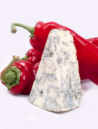 Mold cheese and red pepper on the white bacground. Stock Photo