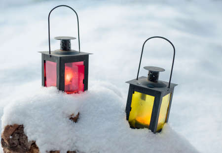 Two lamps set on the snow