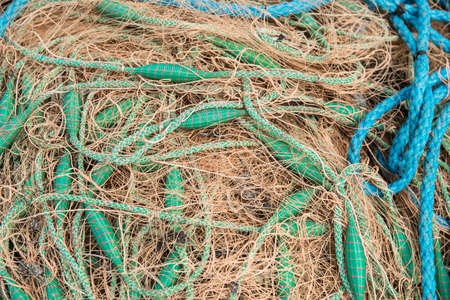 Crowded of fishing net with green and blue ropes Stock Photo