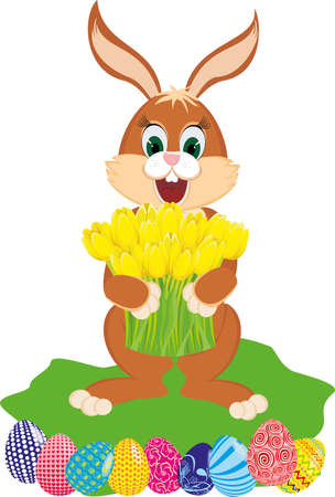 Easter rabbit with yellow tulips and the colored eggs
