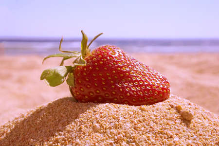 Strawberry fresh. Lay on the sand. Outdoors. Conceptual design ideas for wedding cards. Фото со стока