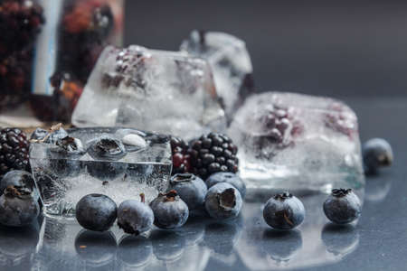 blueberry and blackberry and glass cup