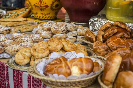 Food background, street showcase with different traditional Ukrainian rolls and pies. Stock Photo