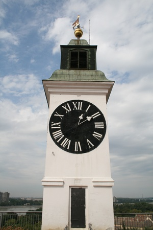 the clock on the tower of the fortress in serbia