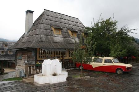 Old Soviet car near a wooden house Stock Photo - 14819833