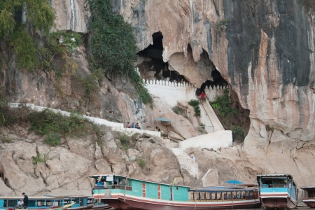 Pak Ou Cave and the boat around it in Laos Stock Photo - 14754699