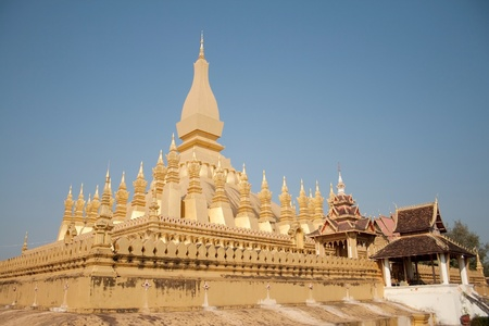 Wat Thap Luang in Vientiane, Laos on blue sky background photo