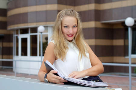 Beautiful young woman is studying documents photo